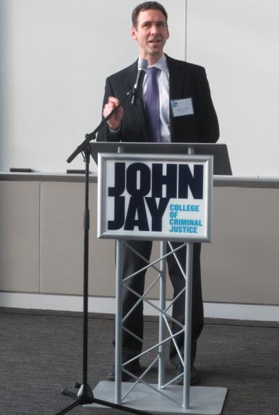 Dean Anthony Carpi, PhD speaking at podium