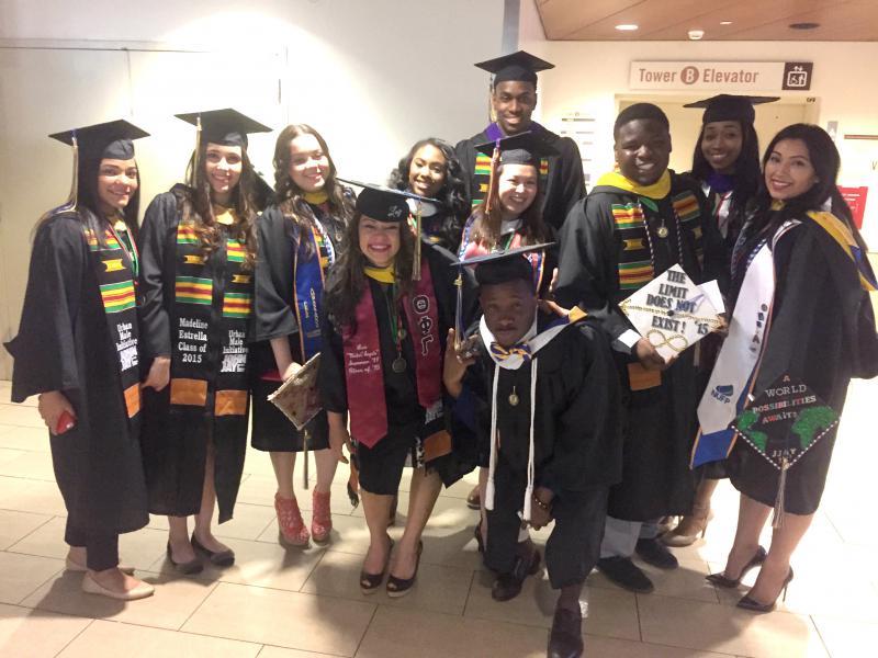 Urban Male Initiative graduates in academic regalia